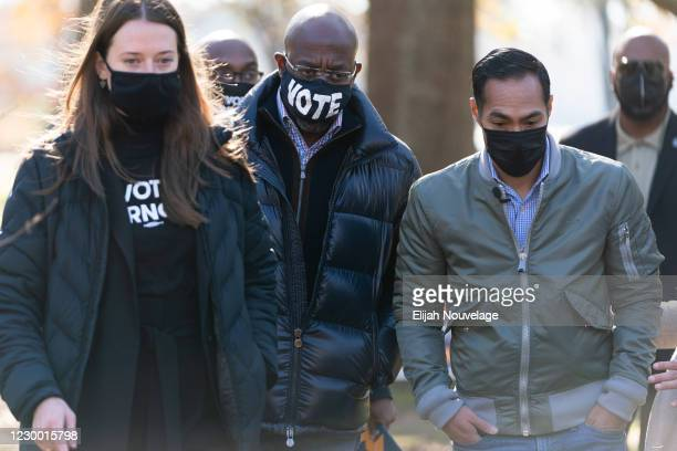 Democratic U.S. Senate candidate Raphael Warnock is seen at a campaign event with former Democratic presidential candidate Julián Castro on December...