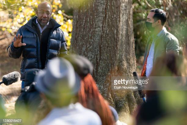 Democratic U.S. Senate candidate Raphael Warnock speaks at a campaign event with former Democratic presidential candidate Julián Castro on December...
