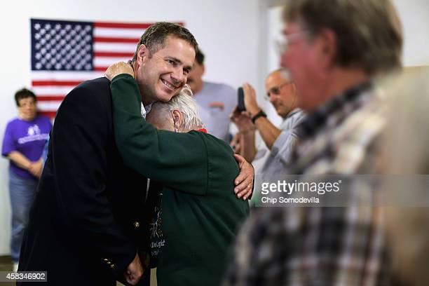 Democratic U.S. Senate candidate Rep. Bruce Braley hugs volunteer Pat Halferty during a campaign stop at the Lynn Count Democratic Headquarters...