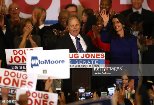 Democratic US Senator elect Doug Jones and wife Louise Jones greet supporters during his election night gathering the Sheraton Hotel on December 12...