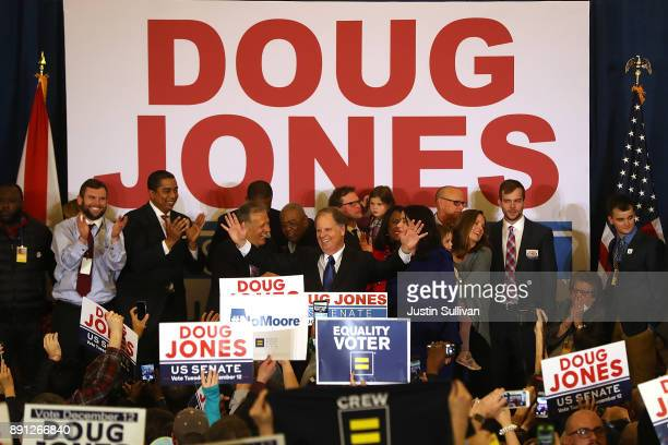 Democratic US Senator elect Doug Jones greets supporters during his election night gathering the Sheraton Hotel on December 12 2017 in Birmingham...