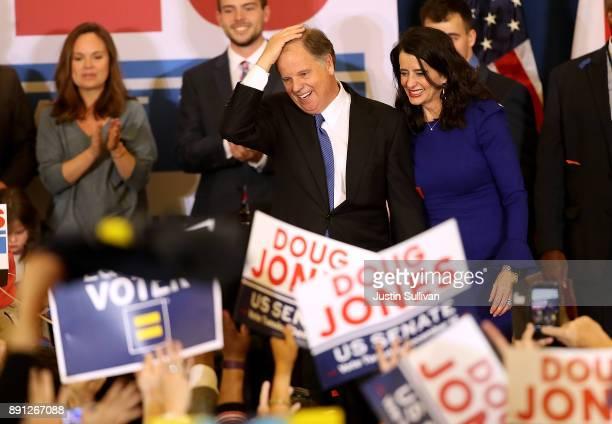 Democratic US Senator elect Doug Jones greets supporters during his election night gathering the Sheraton Hotel on December 12 2017 in Birmingham...