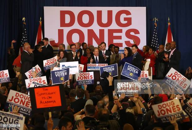 Democratic US Senator elect Doug Jones speaks with supporters during his election night gathering the Sheraton Hotel on December 12 2017 in...