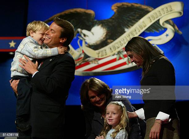 Democratic vice presidential candidate John Edwards hugs his son Jack as his wife Elizabeth younger daughter Emma Claire and older daughter Cate...