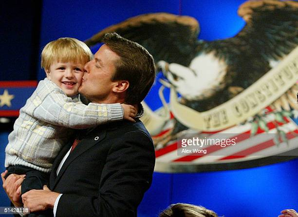 Democratic vice presidential candidate John Edwards kisses his son Jack after a debate with Vice President Dick Cheney October 5 2004 at Case Western...