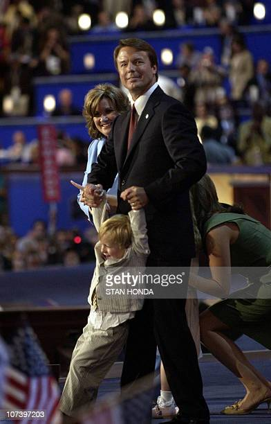 Democratic vice presidential candidate John Edwards swings his son Jack as wife Elizabeth watches on stage at the Democratic National Convention 28...
