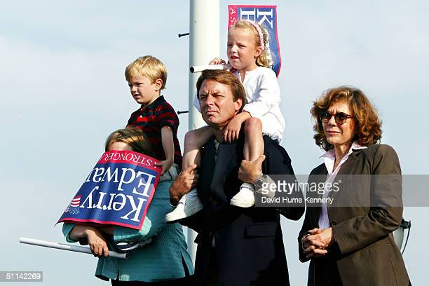 Democratic vice presidential candidate John Edwards with his daughter Emma Claire perched on his shoulders stands next to his wife Elizabeth Edwards...