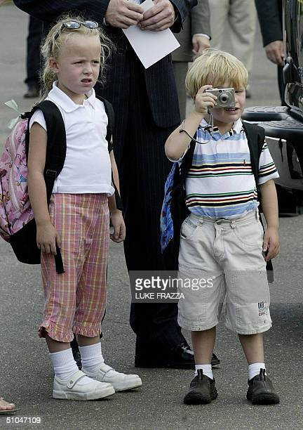 Democratic vice presidential candidate John Edwards's 4yearold son Jack and 6yearold daughter Emma Claire wait for their dad to step off a plane at...