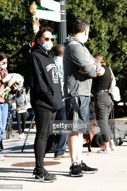 Democratic vice presidential candidate Kamala Harris and her husband, Douglas Emhoff, stop in front of a memorial outside the US Supreme Court as the...