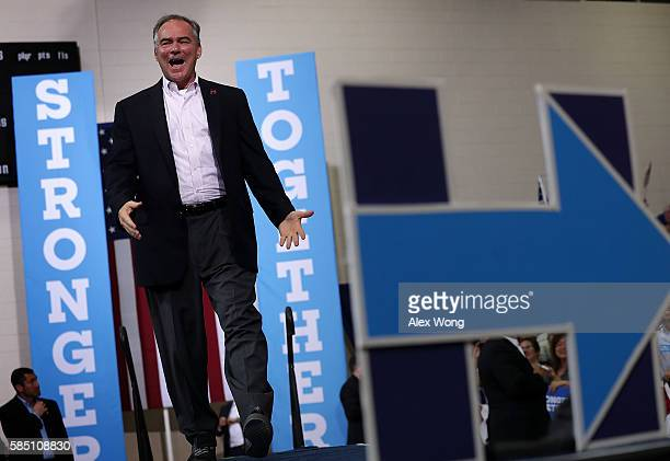 Democratic vice presidential candidate Sen Tim Kaine arrives on stage during a campaign event August 1 2016 in Richmond Virginia Kaine returns to...