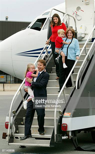 Democratic vice presidential candidate Senator John Edwards arrives in Boston for the Democratic National Convention with his daughter Emma Claire in...