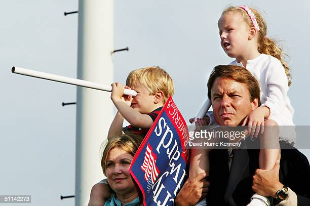 Democratic vice presidential candidate Senator John Edwards with his daughter Emma Claire on his shoulders stands next to his wife Elizabeth and son...