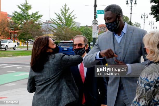 Democratic Vice Presidential candidate Senator Kamala Harris bumps elbows with former Detroit Piston player Ben Wallace , as Arn Tellem , Vice...