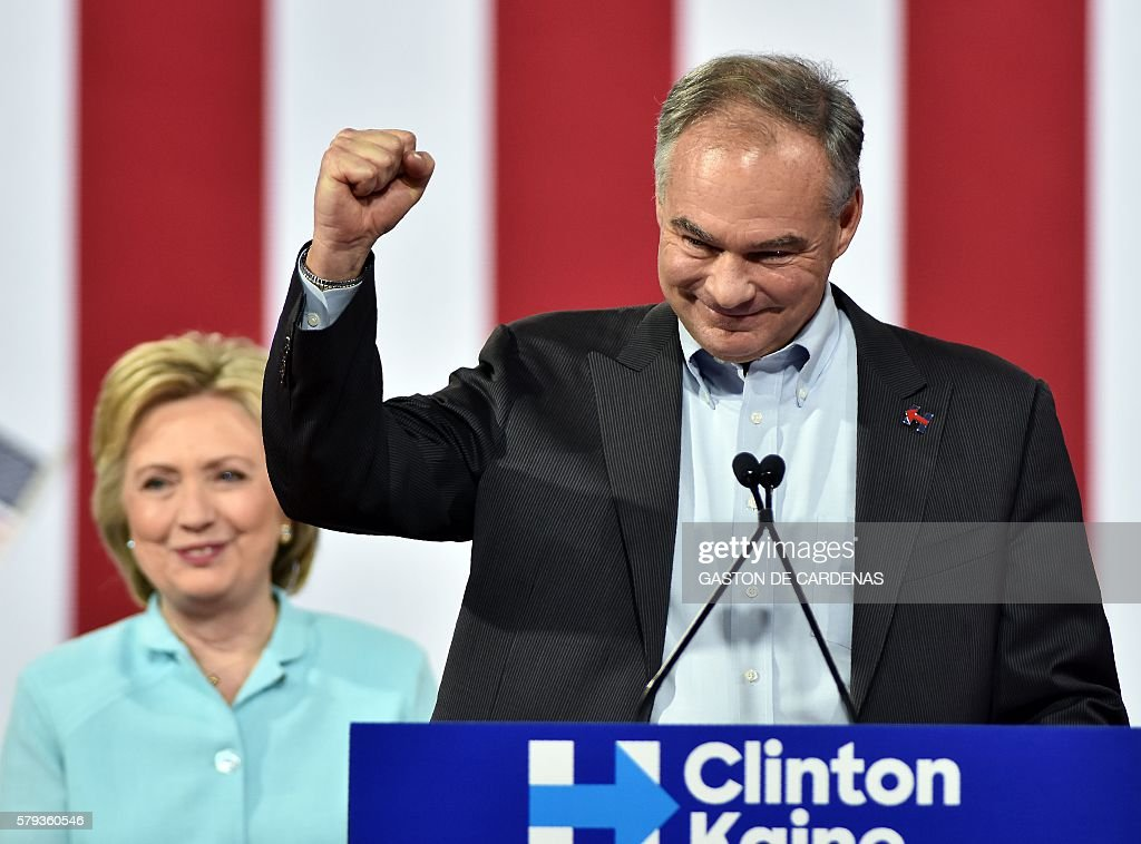 US Democratic vice presidential candidate Tim Kaine speaks alongside Democratic Presidential candidate Hillary Clinton at a campaign rally at Florida International University in Miami on July 23, 2016. / AFP / Gaston De Cardenas