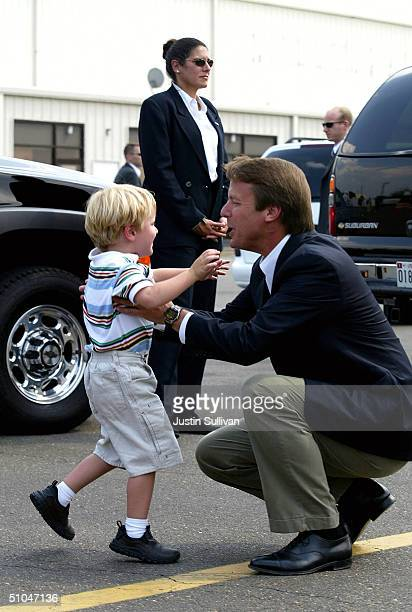 Democratic vice presidential candidate US Sen John Edwards greets his four yearold son Jack after getting off his airplane July 10 2004 in Raleigh...