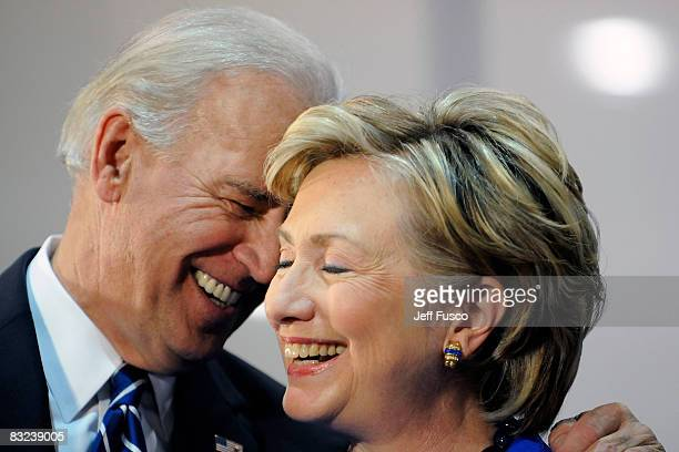 Democratic vice presidential candidate U.S. Senator Joe Biden and U.S. Sen. Hillary Clinton smile at a rally in support of Democratic presidential...