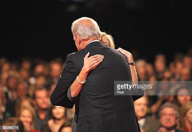 Democratic vice presidential candidate US Senator Joe Biden embraces his wife Jill during the vice presidential debate with Republican vice...