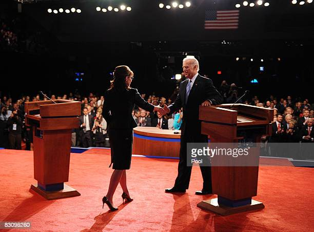 Democratic vice presidential candidate US Senator Joe Biden greets Republican vice presidential candidate Alaska Gov Sarah Palin during the vice...