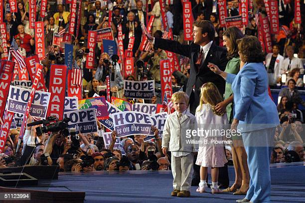 Democratic vice presidential candidate US Senator John Edwards acknowledges the crowd with his family from left son Jack daughter Emma Claire older...