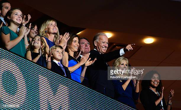 Democratic vice presidential candidate US Vice President Joe Biden points as he stands with his wife Second lady Dr Jill Biden and family during the...