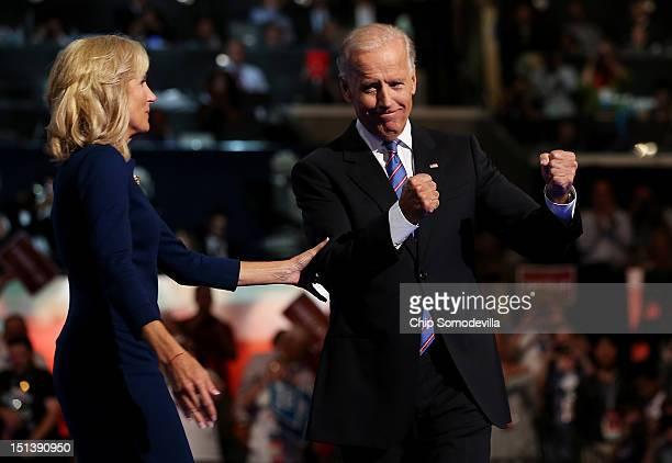 Democratic vice presidential candidate US Vice President Joe Biden joins his wife Second lady Dr Jill Biden after speaking during the final day of...