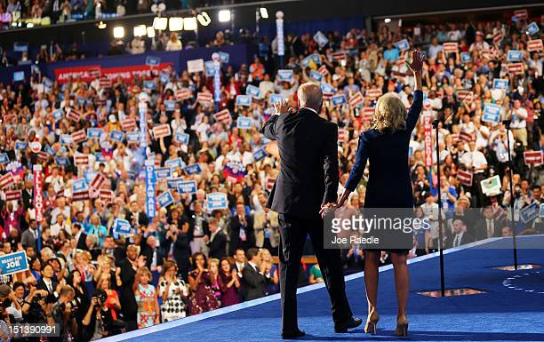 Democratic vice presidential candidate US Vice President Joe Biden waves with his wife Second lady Dr Jill Biden after speaking on stage during the...