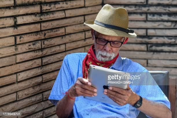 Democratic vice presidential nominee and Senator from California, Kamala Harris' uncle Balachandran Gopalan watches the vice presidential debate on a...