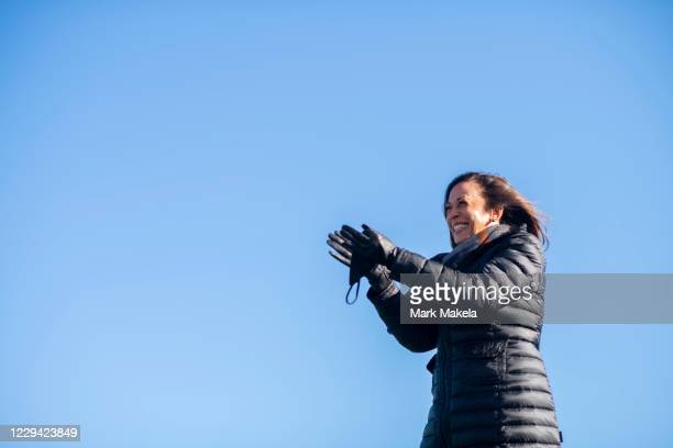 Democratic vice presidential nominee Sen. Kamala Harris acknowledges the crowd while arriving at a drive-in rally on the eve of the general election...