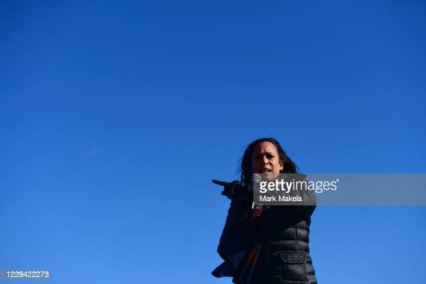 Democratic Vice Presidential Nominee Sen. Kamala Harris addresses supporters during a drive-in rally on the eve of the general election on November...