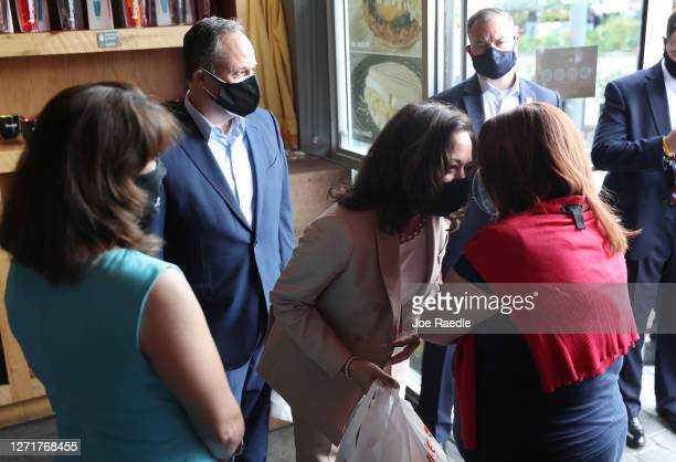 Democratic Vice Presidential Nominee Sen. Kamala Harris and her husband, Doug Emhoff , greet people during a stop at the Amaze restaurant on...
