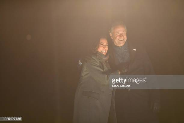 Democratic vice presidential nominee Sen. Kamala Harris and husband, Douglas Emhoff, take the stage after Democratic presidential nominee Joe Biden...