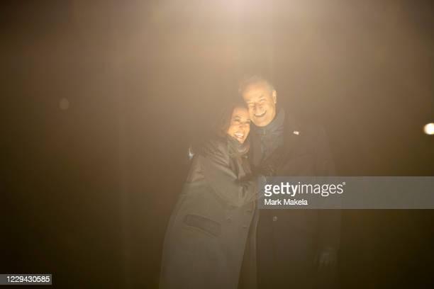 Democratic vice presidential nominee Sen. Kamala Harris and husband, Douglas Emhoff, embrace on stage after Democratic presidential nominee Joe Biden...
