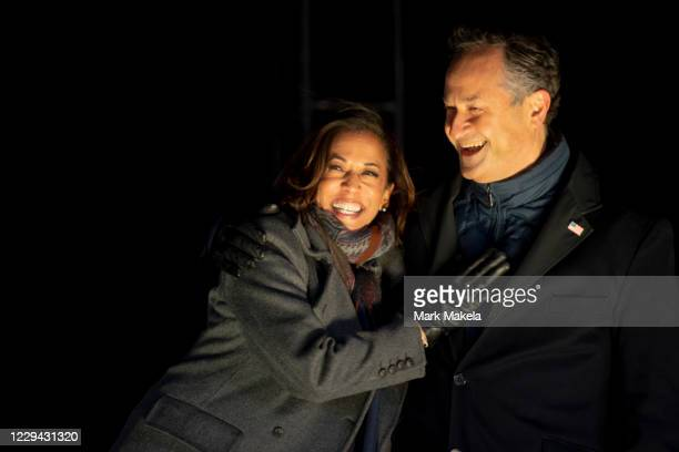 Democratic vice presidential nominee Sen. Kamala Harris and husband, Douglas Emhoff, embrace on stage after Democratic presidential nominee Joe Biden...