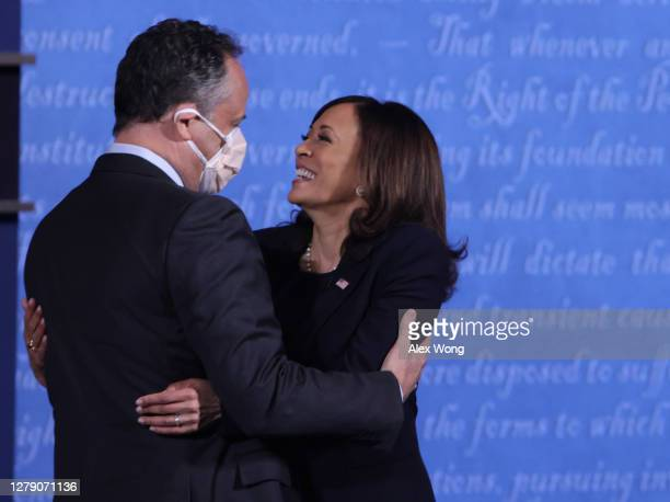 Democratic vice presidential nominee Sen. Kamala Harris hugs husband Douglas Emhoff after in the vice presidential debate against U.S. Vice President...