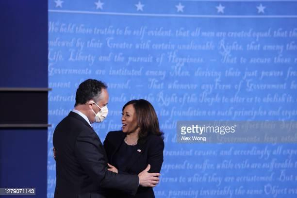 Democratic vice presidential nominee Sen. Kamala Harris hugs husband Douglas Emhoff after in the vice presidential debate against U.S. Vice President...