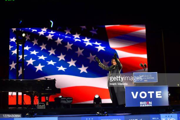Democratic vice presidential nominee Sen. Kamala Harris takes the stage to speak at a drive-in election eve rally on November 2, 2020 in...