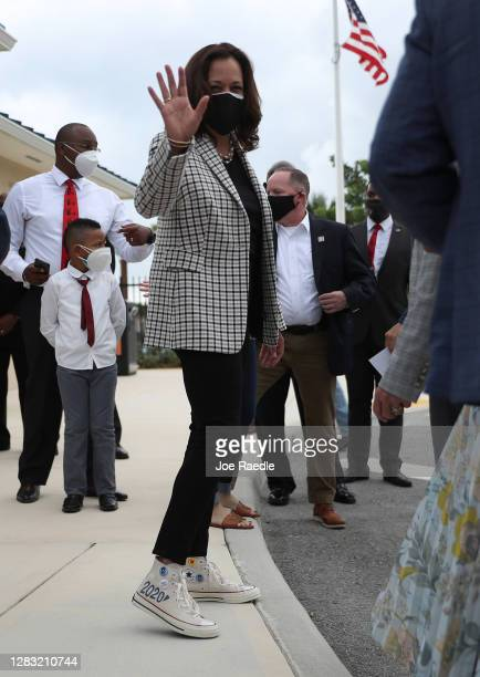 Democratic Vice Presidential Nominee Sen. Kamala Harris waves after speaking to the media during a stop at Buccaneer Park on October 31, 2020 in...