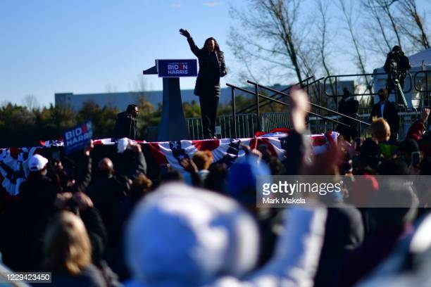 Democratic vice presidential nominee Sen. Kamala Harris waves farewell after speaking during a drive-in rally on the eve of the general election on...