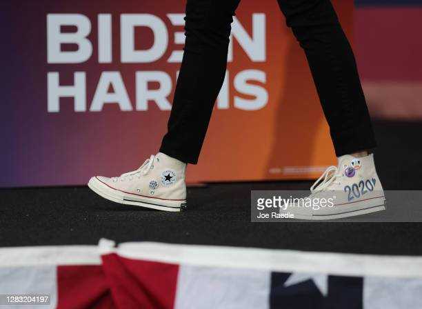 Democratic Vice Presidential Nominee Sen. Kamala Harris wears shoes with the year 2020 on them as she makes a campaign stop at Florida International...