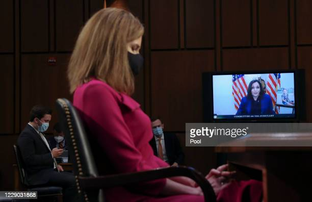 Democratic vice presidential nominee Senator Kamala Harris speaks by video conference as Judge Amy Coney Barrett listens during the first day of her...