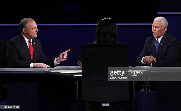 Democratic vice presidential nominee Tim Kaine and Republican vice presidential nominee Mike Pence speak as debate moderator Elaine Quijano listens...