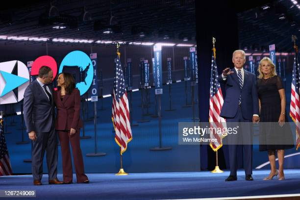 Democratic vice presidential nominee U.S. Sen. Kamala Harris and her husband Douglas Emhoff and Democratic presidential nominee Joe Biden and his...