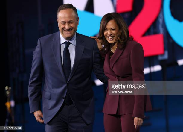 Democratic vice presidential nominee U.S. Sen. Kamala Harris and her husband Douglas Emhoff appear on stage after Harris delivered her acceptance...