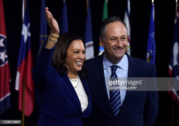 Democratic vice presidential running mate, US Senator Kamala Harris and her husband Douglas Emhoff pose on stage after the first Biden-Harris press...