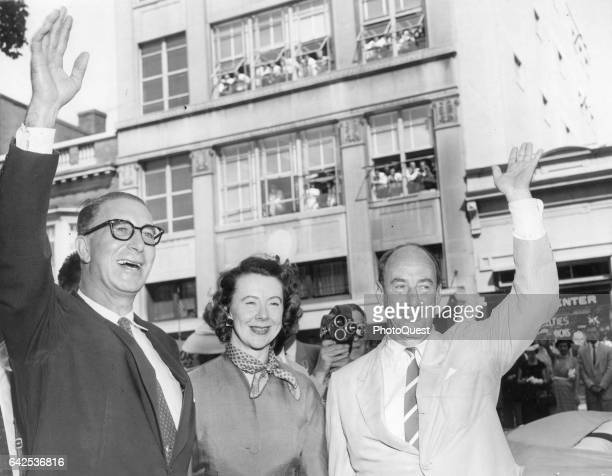 Democratic Vicepresidential nominee Estes Kefauver his wife Nancy Kefauver and Presidential nominee Adlai Stevenson II wave as they arrive to open a...