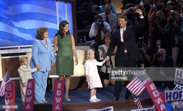 Democratic Vicepresidential nominee Sen John Edwards right holds his daughter Emma Claire's hand as his wife Elizabeth second from left son Jack left...