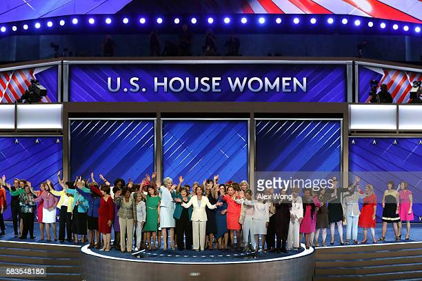Democratic women members of the House of Representatives wave to the crowd after delivering remarks on the second day of the Democratic National...