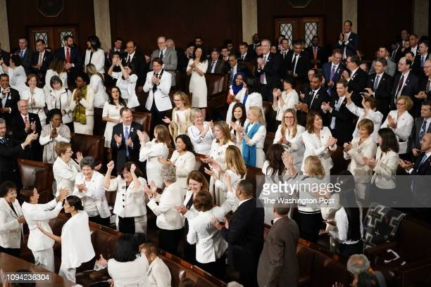Democratic women stand and cheer after Donald Trump recognizes the record number of women will be serving in 116th Congress during his State of the...