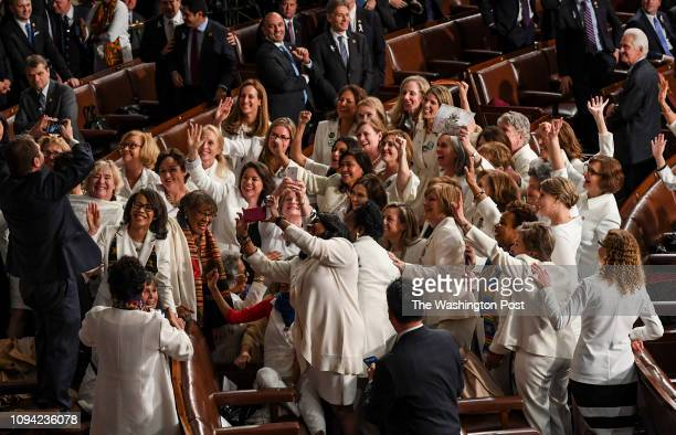 Democratic women wear white as a reference to the suffragette movement at the State of the Union address before members of Congress in the House...