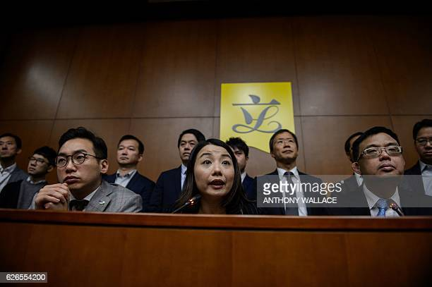 Democratically elected lawmaker teacher Lau Siulai from the 'Democracy Groundwork' party holds a press conference with other lawmakers at the...